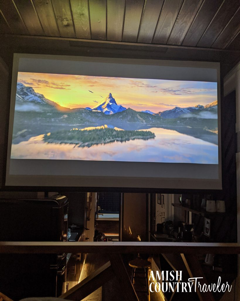 Projector screen in The Lux - a modern tiny home/cabin in Berlin, Ohio.